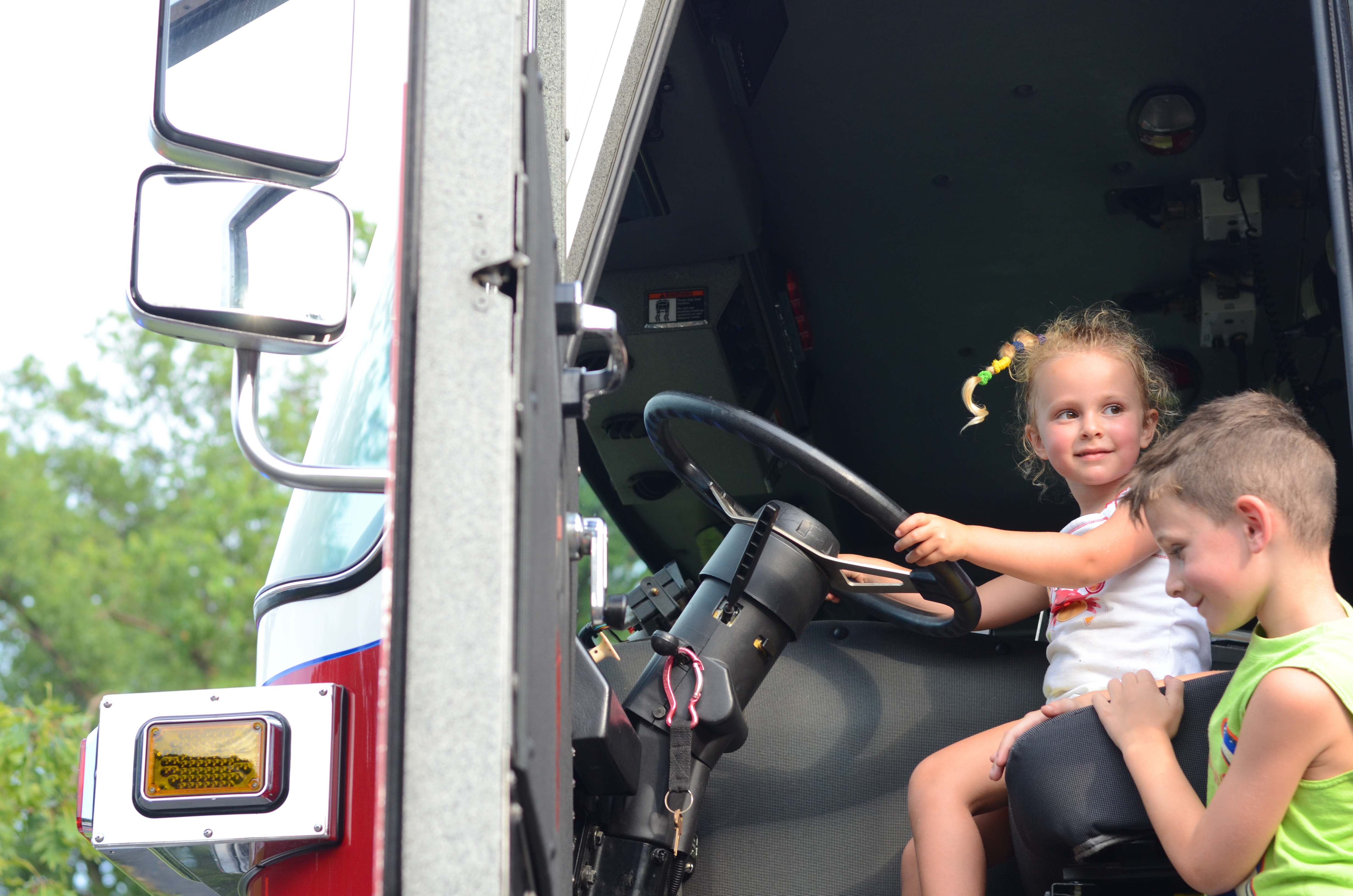 children explore fire truck