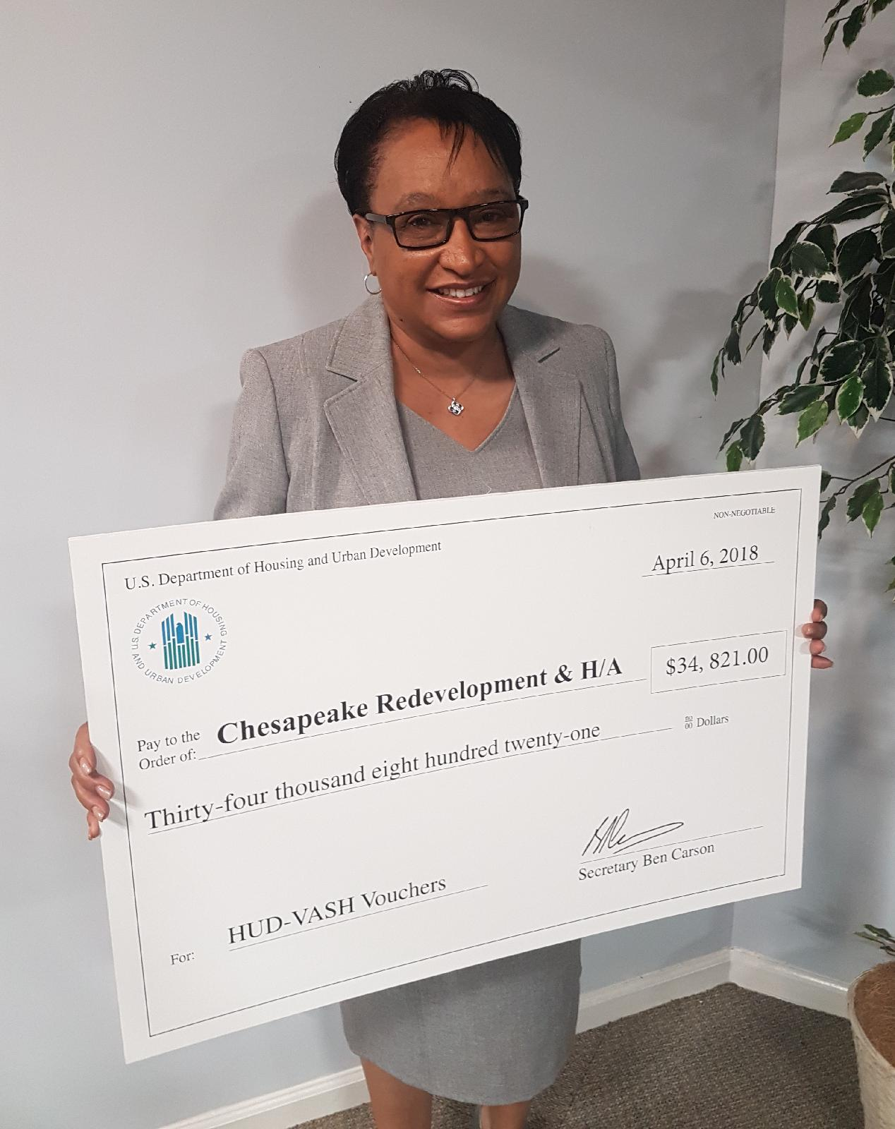Brenda with VASH voucher award from HUD April 2018A