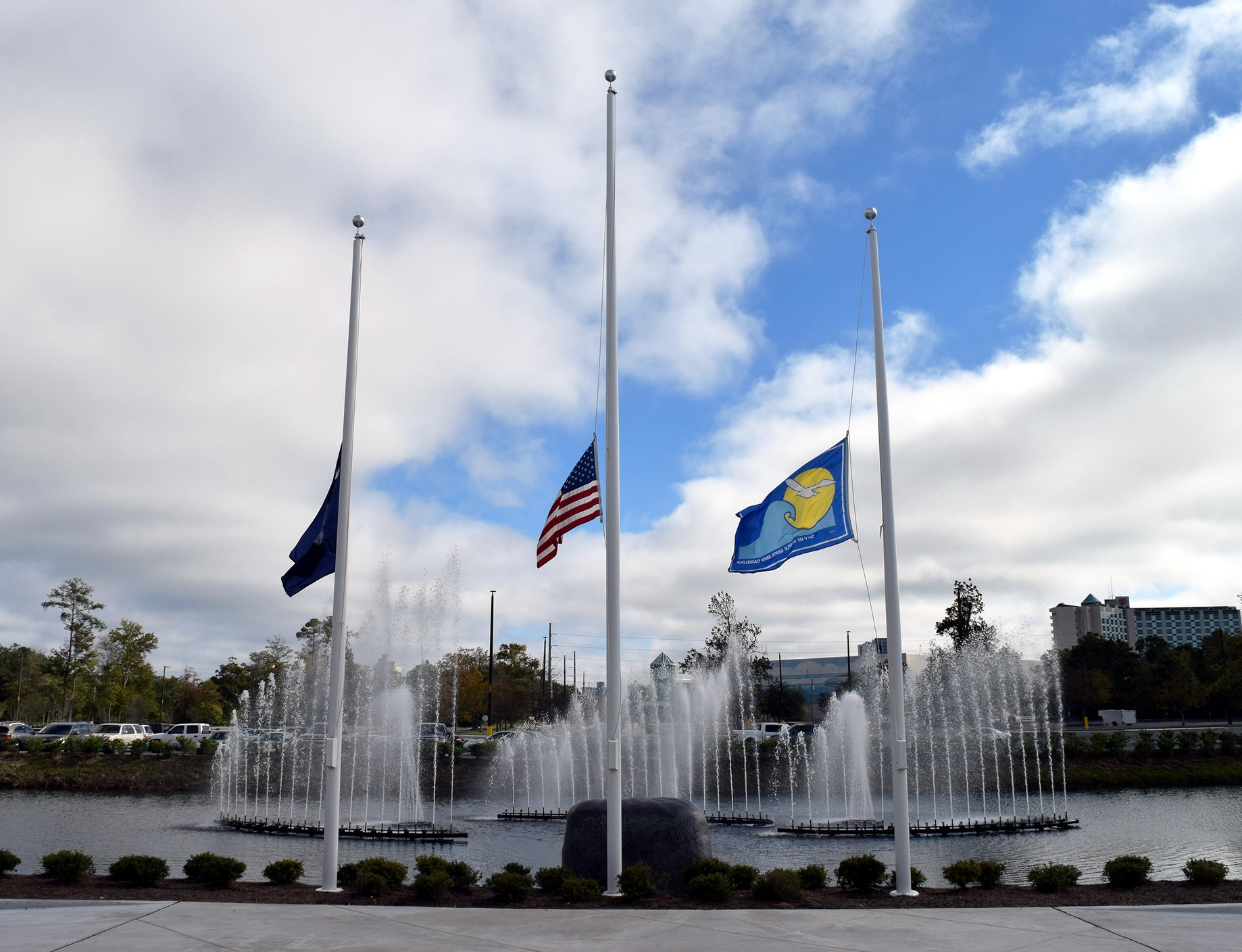 flags at half staff Sports Center