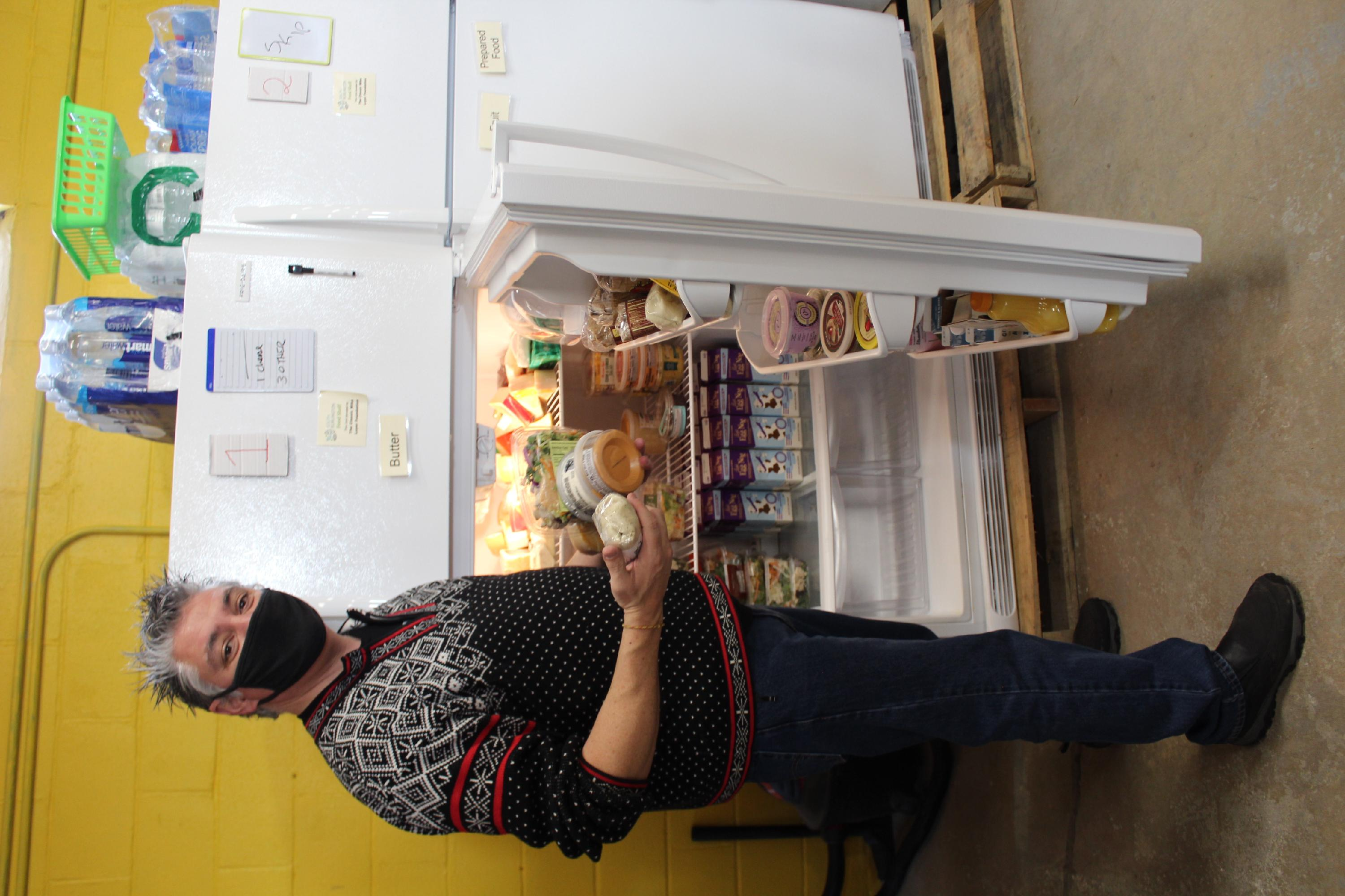 Food Shelf - volunteer at freezer